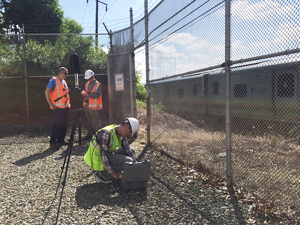 A crew measures the noise of a passing train as part of the LIRR Expansion Project environmental review.