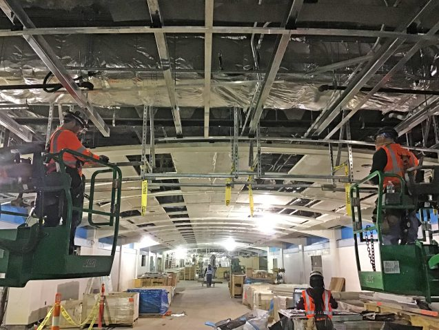 Hanging framing to support finishes going up at 46th Street in the LIRR passenger concourse. 04-19-19