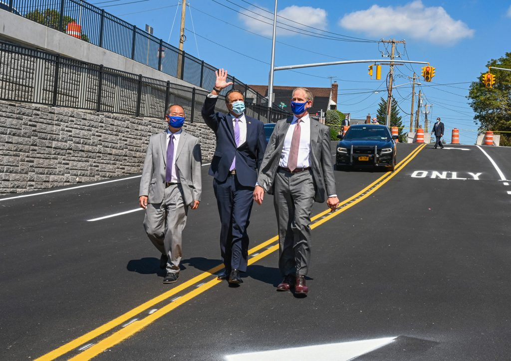 Garden City-- Governor Andrew M. Cuomo, joined by LIRR President Phil Eng, and Janno Lieber, right, cuts the ribbon on a newly completed car underpass which eliminates the Long Island Rail Road grade crossing on New Hyde Park Road in Garden City August 24, 2020. The LIRR Expansion Project will introduce 9.8 miles of a new third track on the Main Line, close dangerous grade crossings and upgrade stations along this heavily traversed corridor. (Kevin P. Coughlin / Office of Governor Andrew M. Cuomo) - 08-24-2020