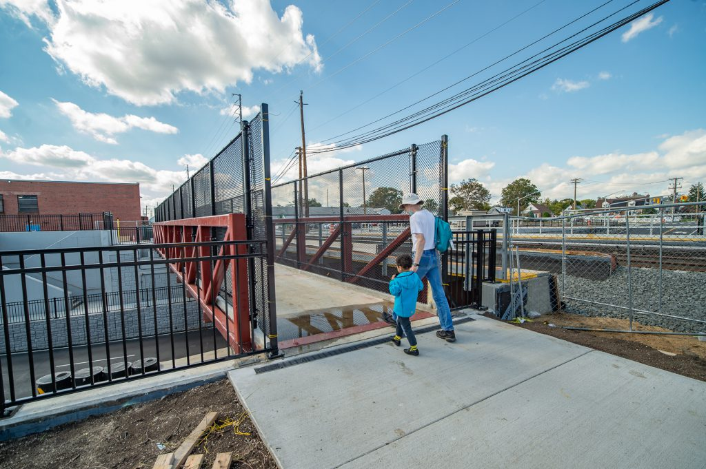 ADA-compliant pedestrian bridge over New Hyde Park Rd undergrade crossing